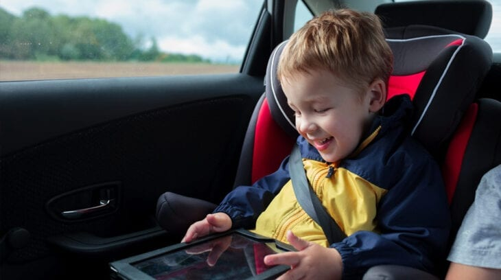 Child on ipad in Car