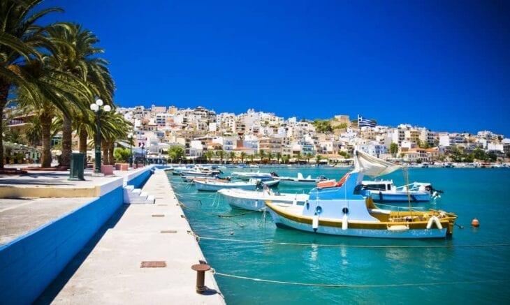 sea bay moored boats promenade in Sitia