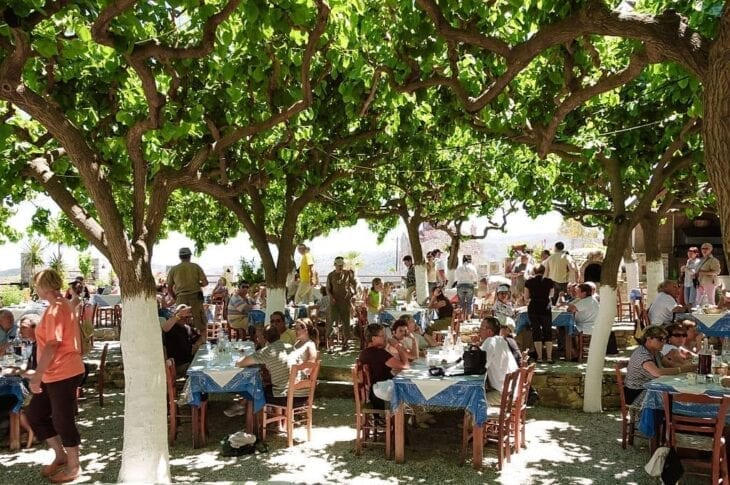 Tourists in Restaurant in Fodele Town