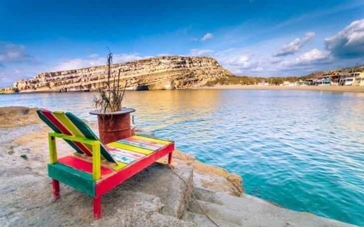 Colorful wooden Longchair in Matala Beach
