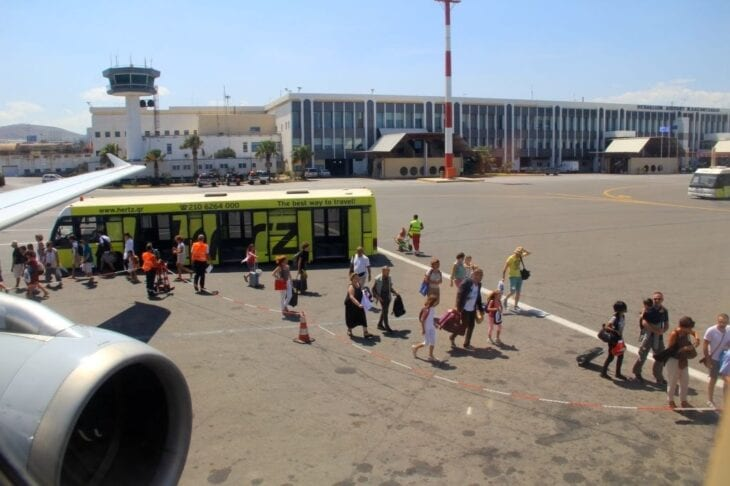Travellers boarding to their plane at Heraklion Airport