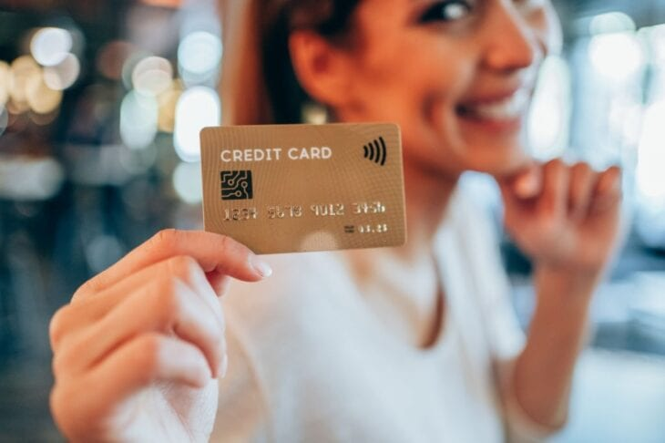Girl showing a credit card
